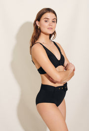 Our Melina Bikini Hipster is made in soft recycled polyester fabric in classic black. Sustainable swimwear.