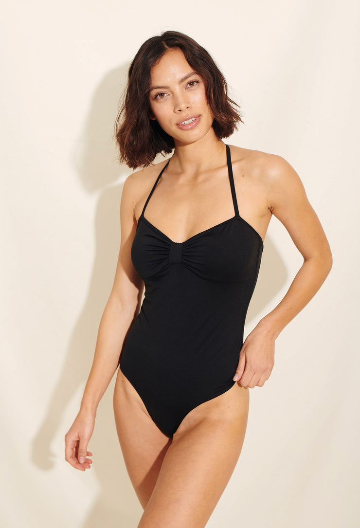 Our Melina Swimsuit is made in soft recycled polyester fabric in classic black. Sustainable swimwear.