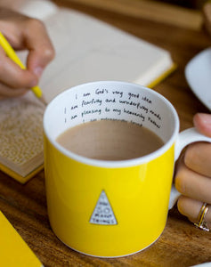 Girl's Book and Yellow Mug