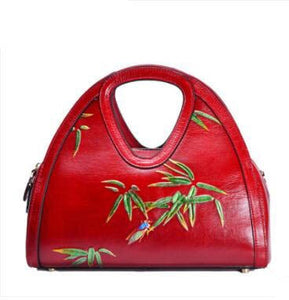 Embossed Leather Handbag with Bamboo Design