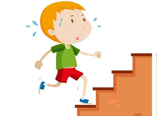 A boy struggling with climbing stairs
