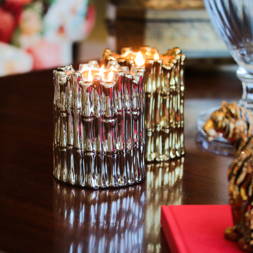 silver and gold round bamboo candles