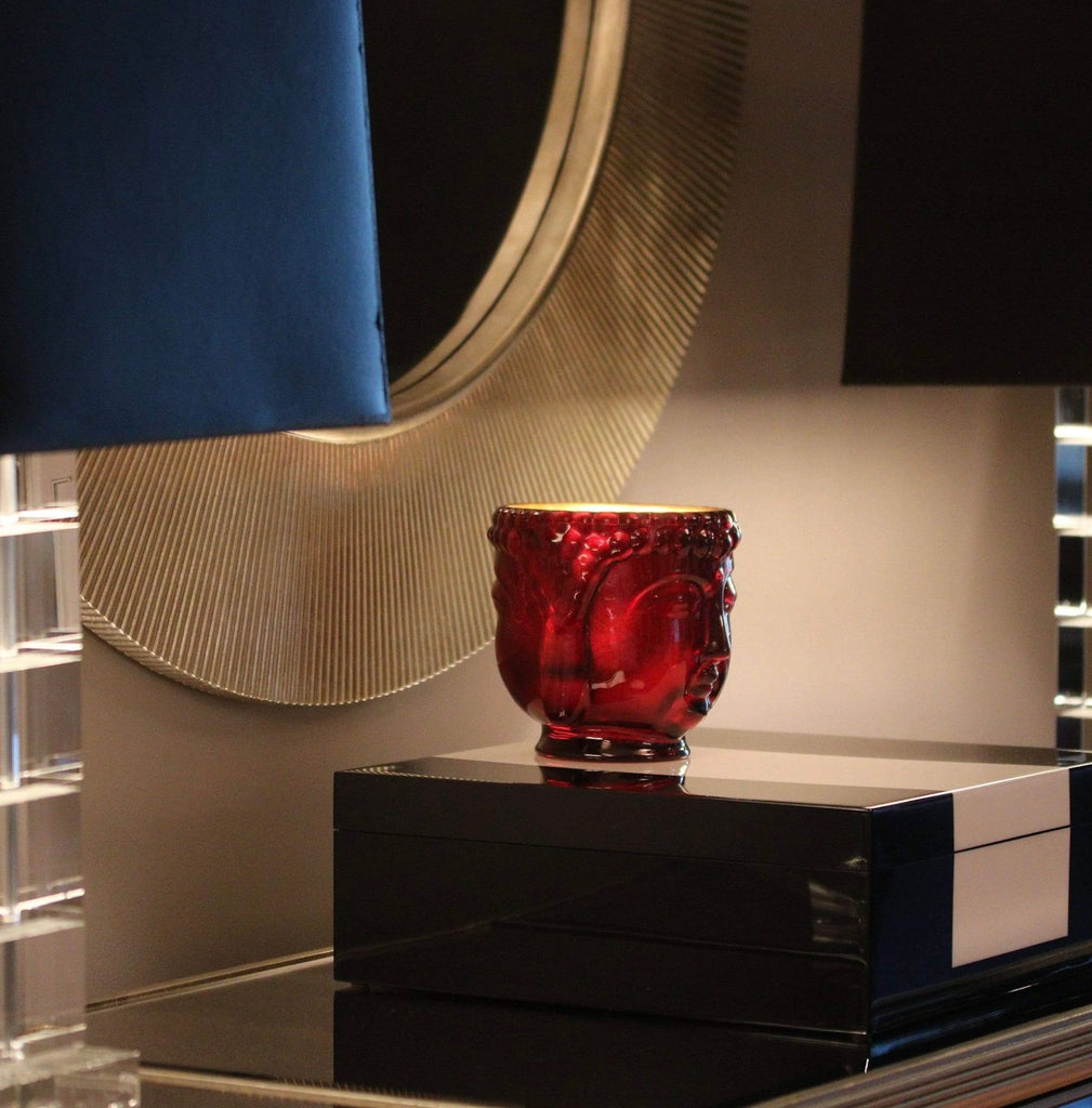 Red glass buddha head candle lined with gold leaf
