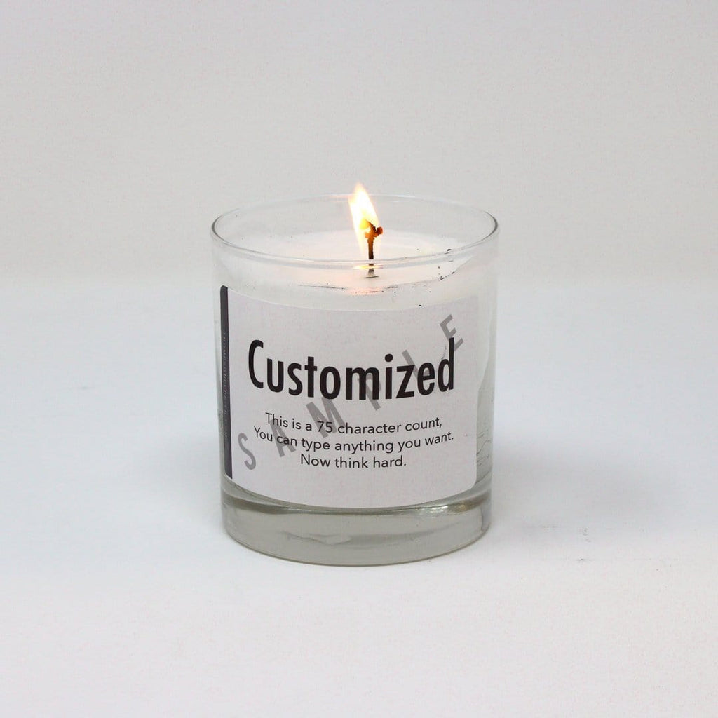 Thompson Ferrier clear glass vessel scented candle with customized label printed on
