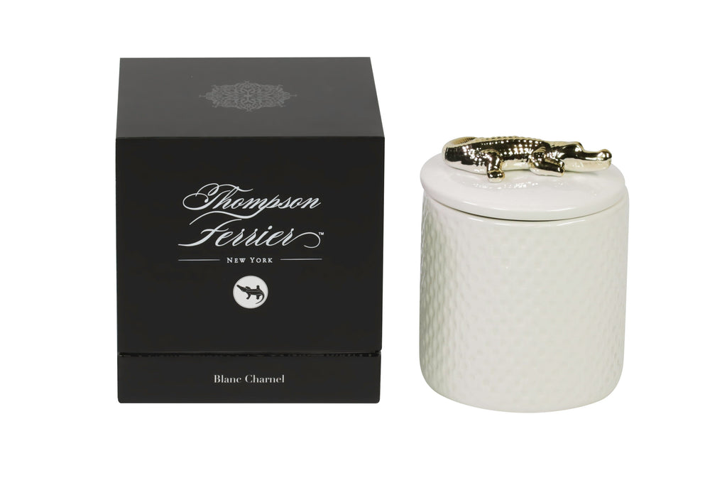 white ceramic lidded candle with gold crocodile embellishment