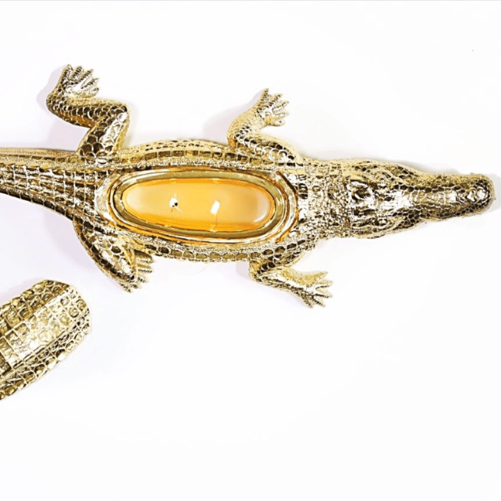 gold ceramic decorative alligator candle filled with white soy wax and two cotton wicks