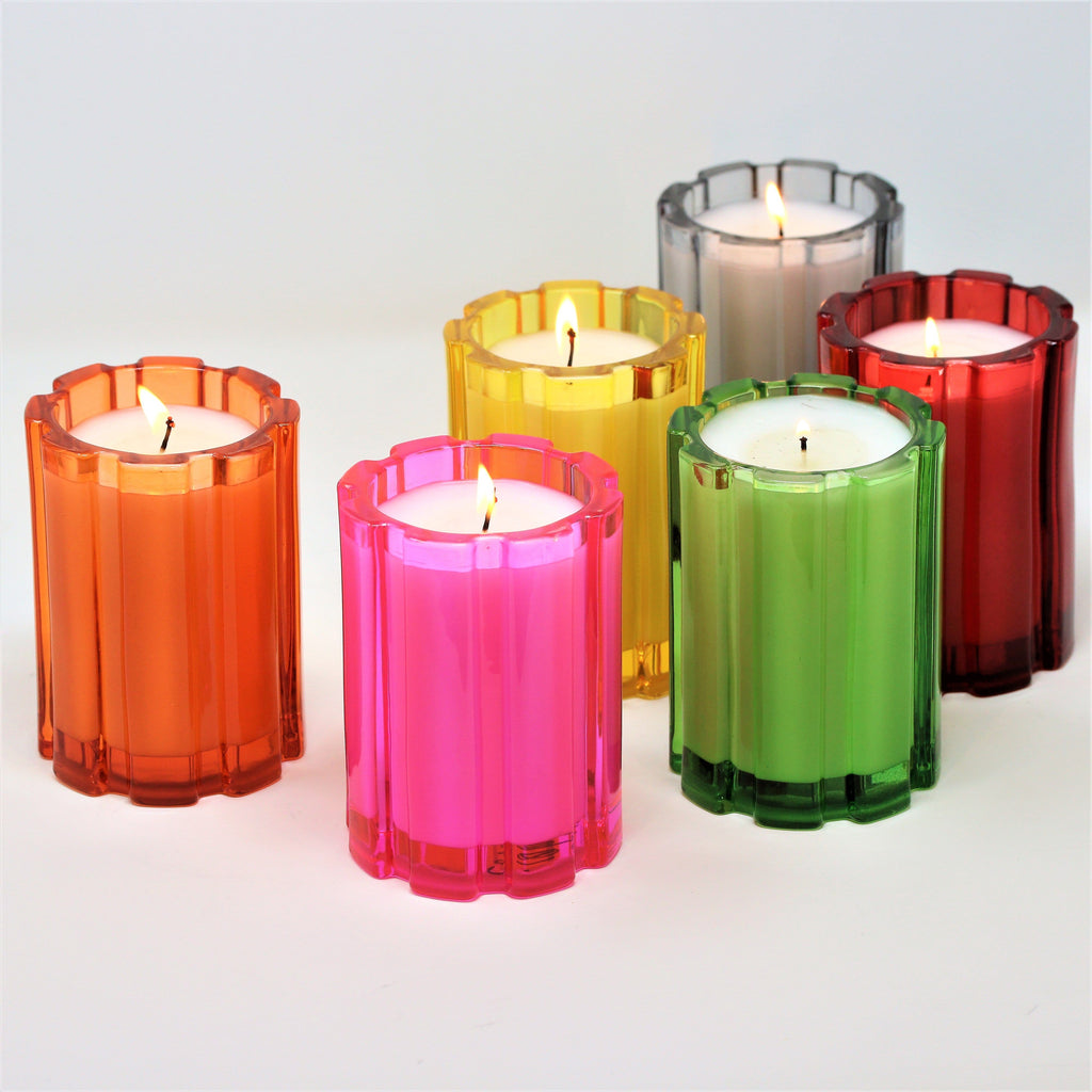 colorful glass candles with white wax and a single cotton wick