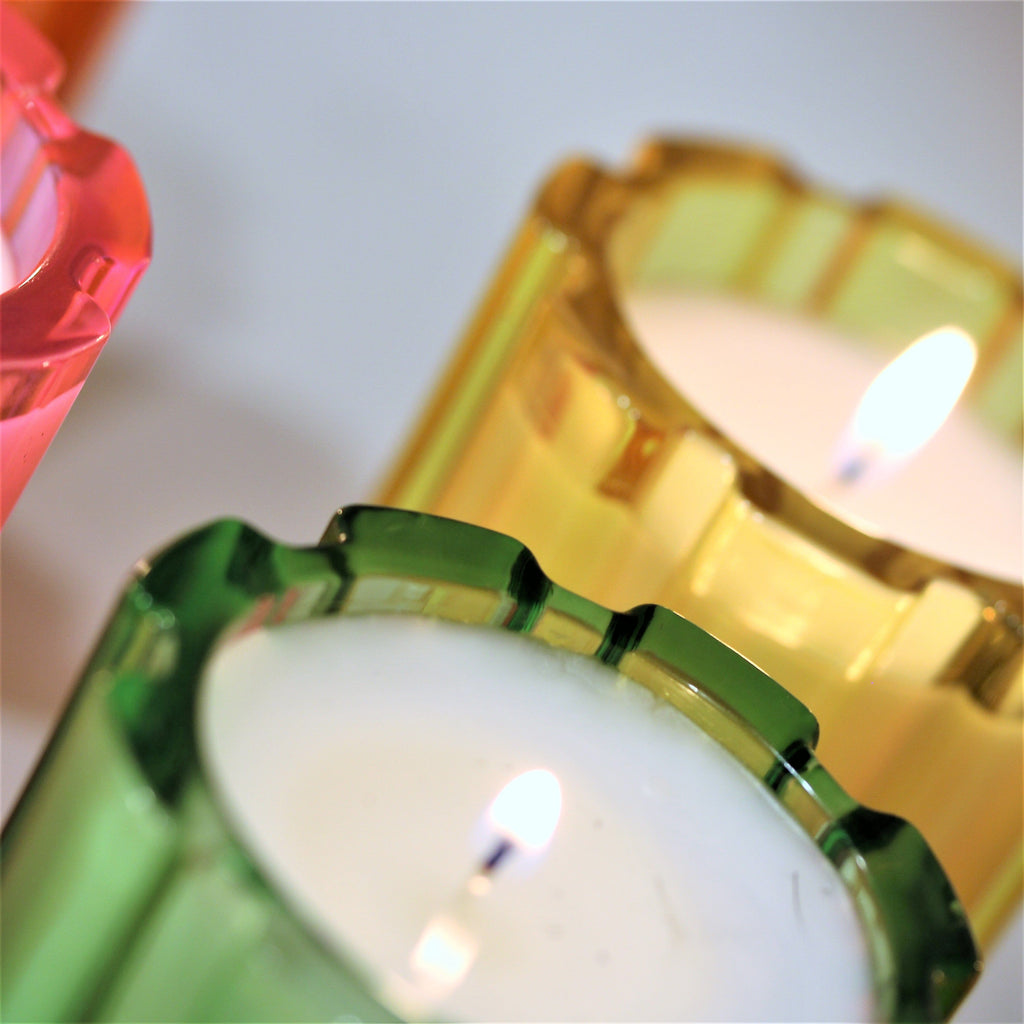 colorful glass candle vessels with one wick and highly fragranced soy wax