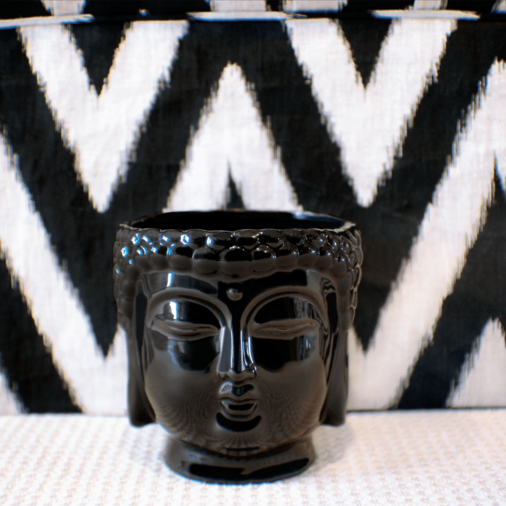 black ceramic buddha head candle with soy wax, essential oils and 3 wicks
