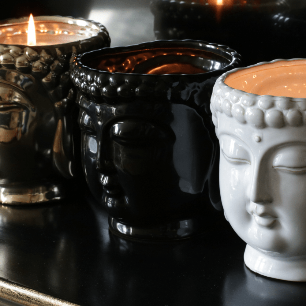 Thompson Ferrier's Black Buddha 3-wick scented candle in Aftershave, is hand-sculpted and hand-poured in the USA with only the finest essential oils. Thompson Ferrier's unique candle, designed in our NYC office is ceramic and each vessel is filled with highly fragranced essential oils and a proprietary soy wax blend.