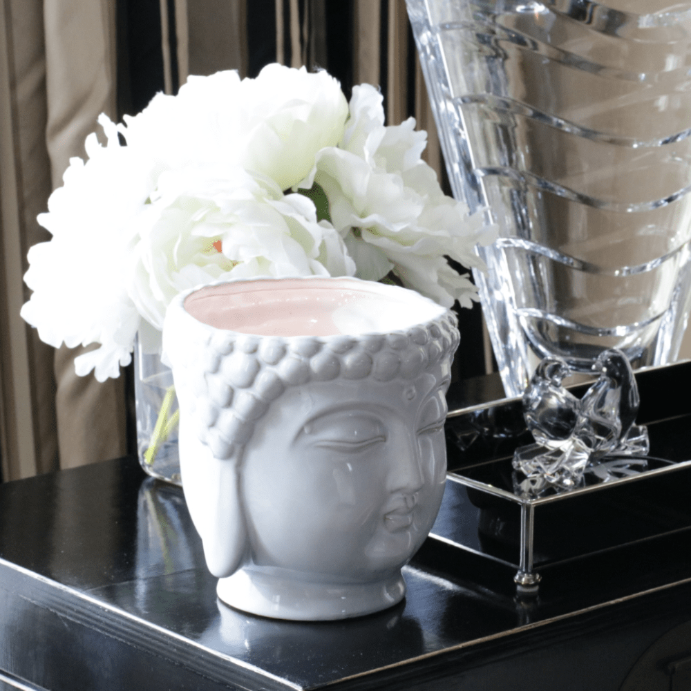 Thompson Ferrier white buddha head candle with 3 wicks