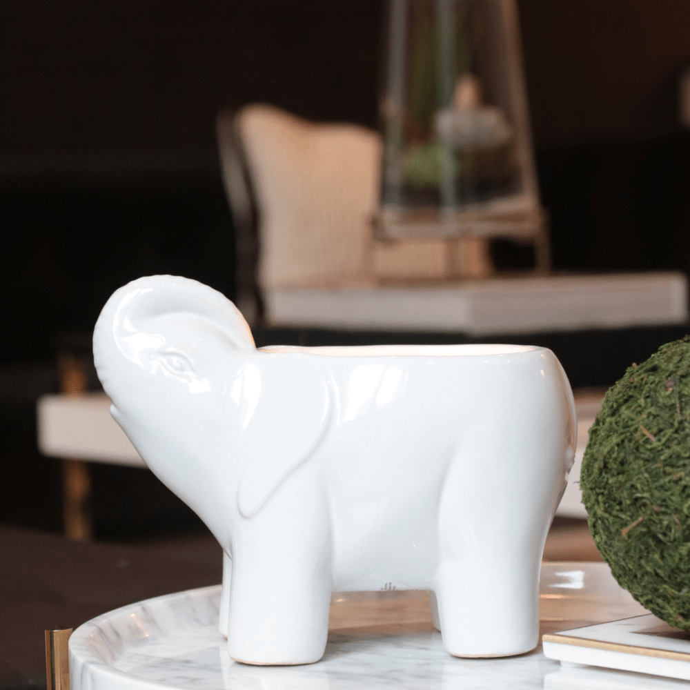 white ceramic elephant candle