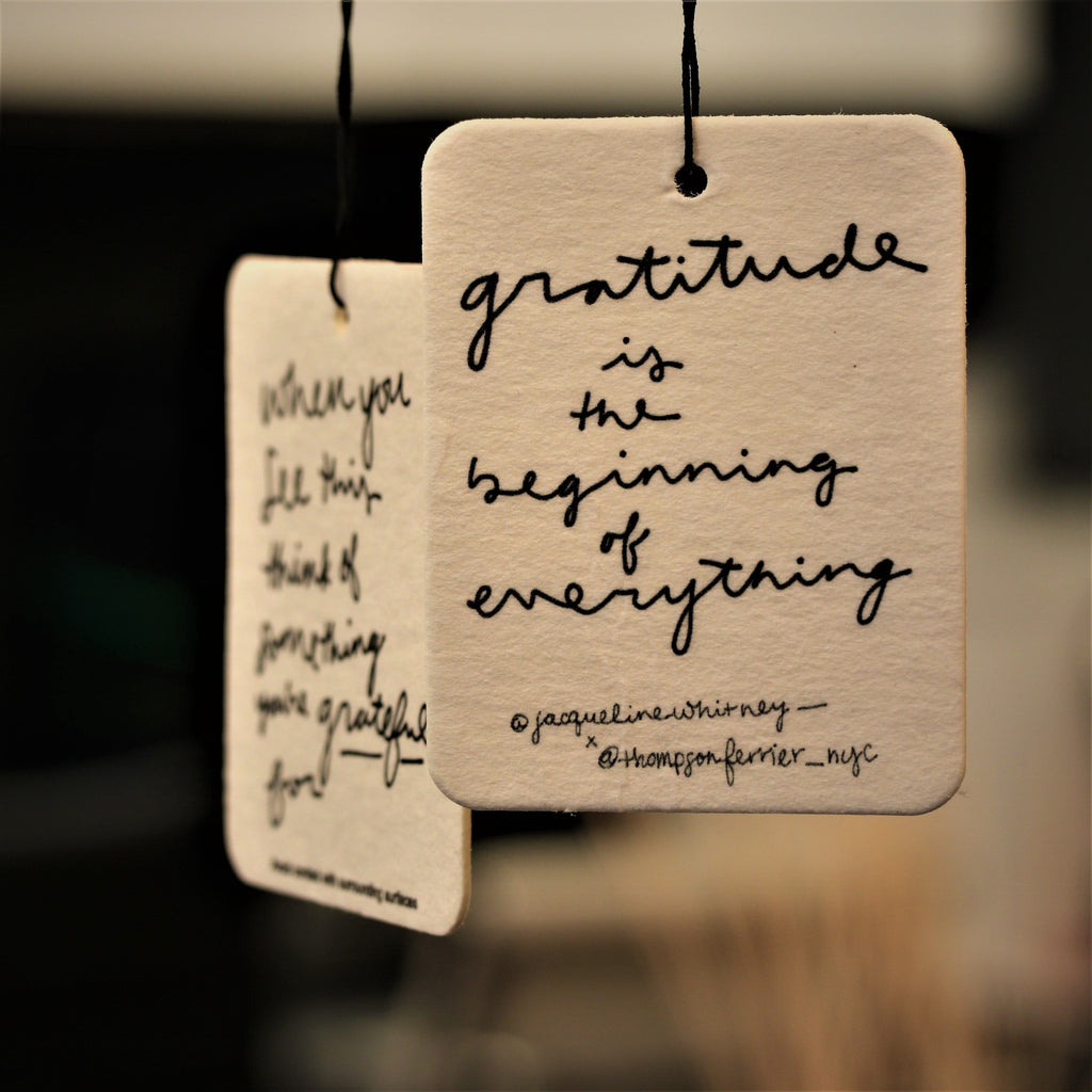 hanging scented air freshener with inspirational handwritten quote