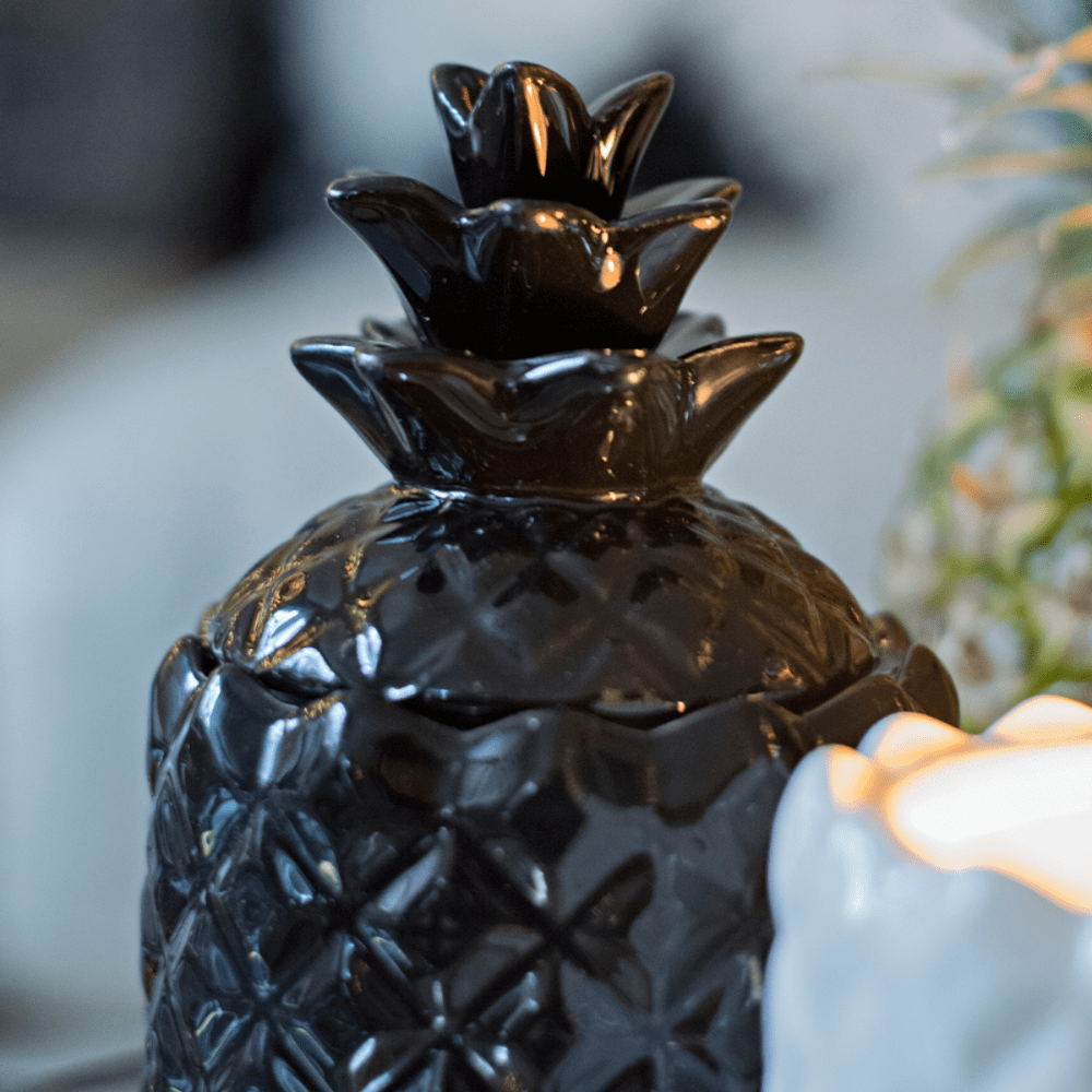 black decorative lidded ceramic pineapple candle