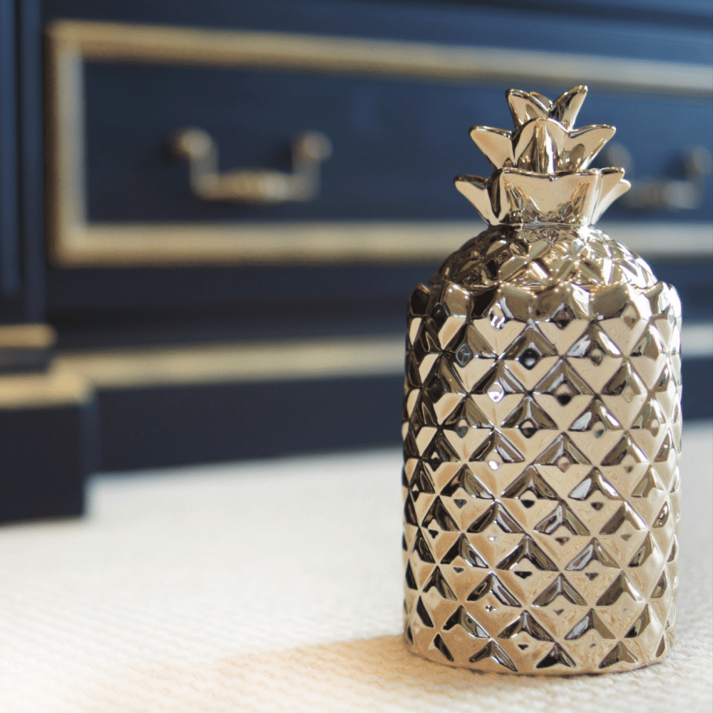 Thompson Ferrier champagne colored pineapple candle with decorative lid