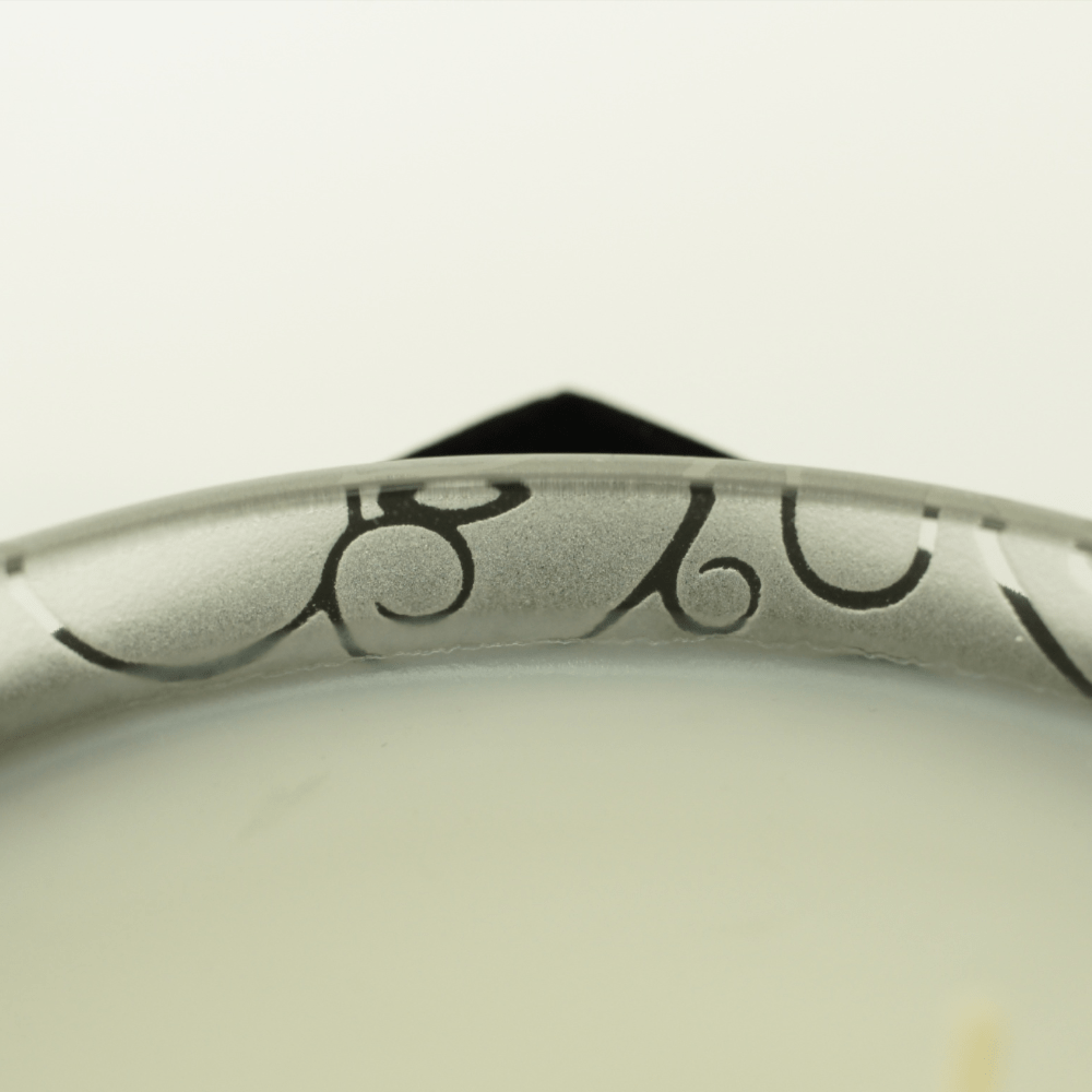 frosted glass vessel with engraved etching, white wax and two cotton wicks