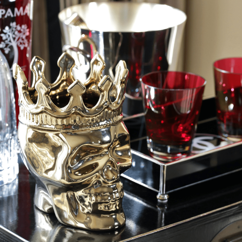 gold ceramic skull candle with crown and 1 cotton wick