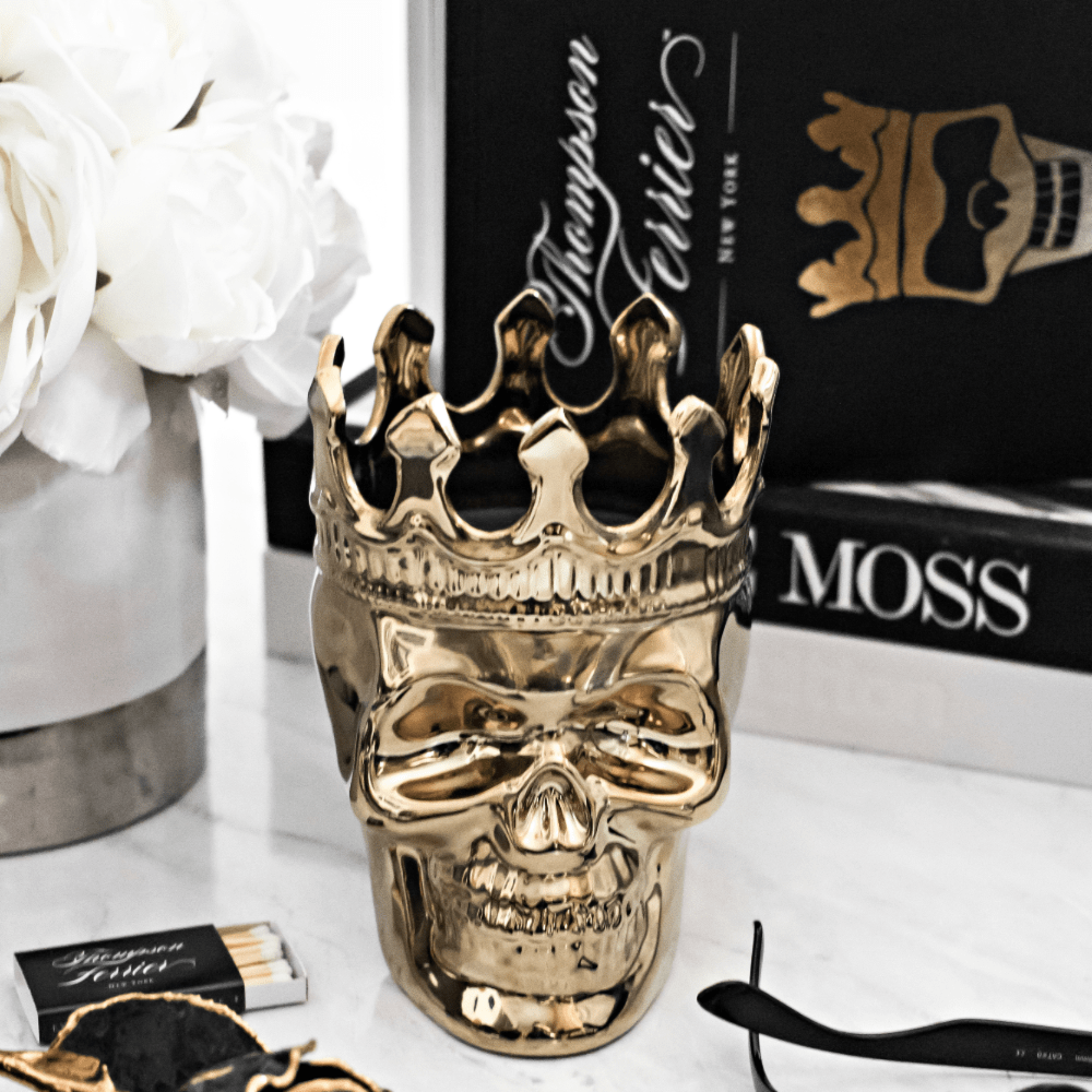 Thompson Ferrier gold skull candle with crown