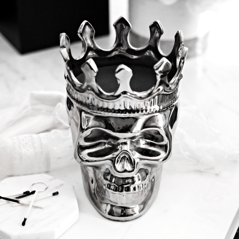 Thompson Ferrier silver skull candle with crown and black wax and 1 wick