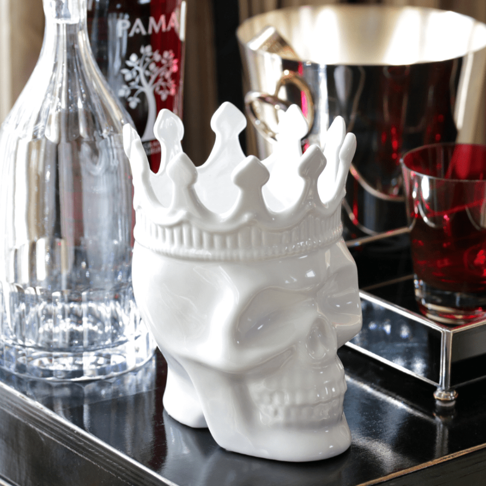 ceramic white skull candle with a crown and 1 cotton wick