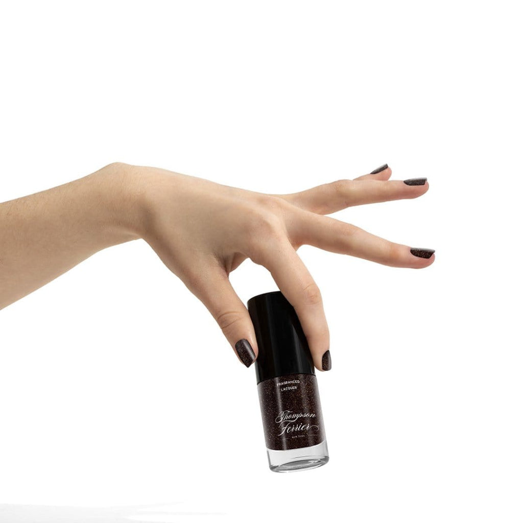 glass-nail-polish-bottle-with-shimmery-brown-polish