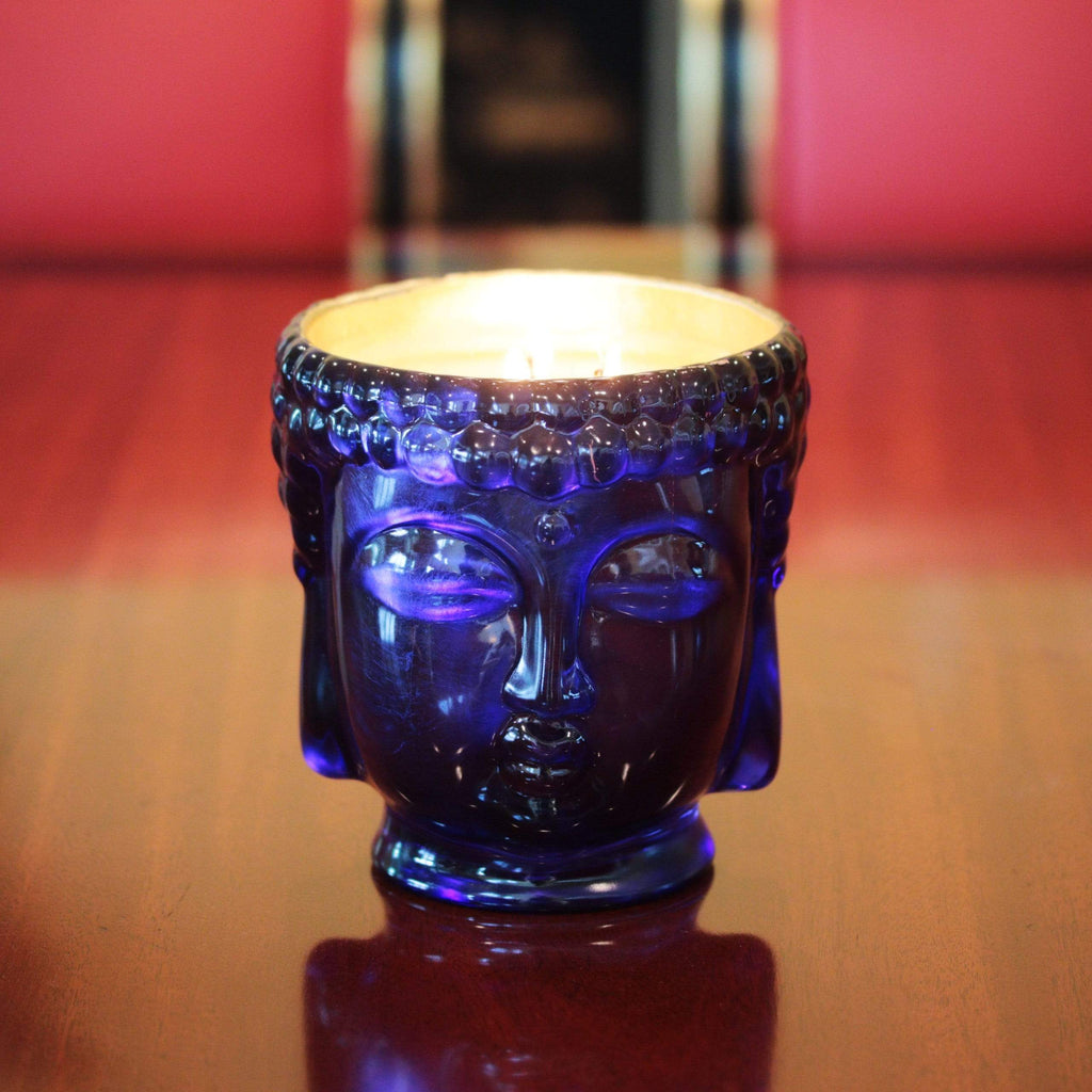 blue glass buddha head candle lined with 24K gold