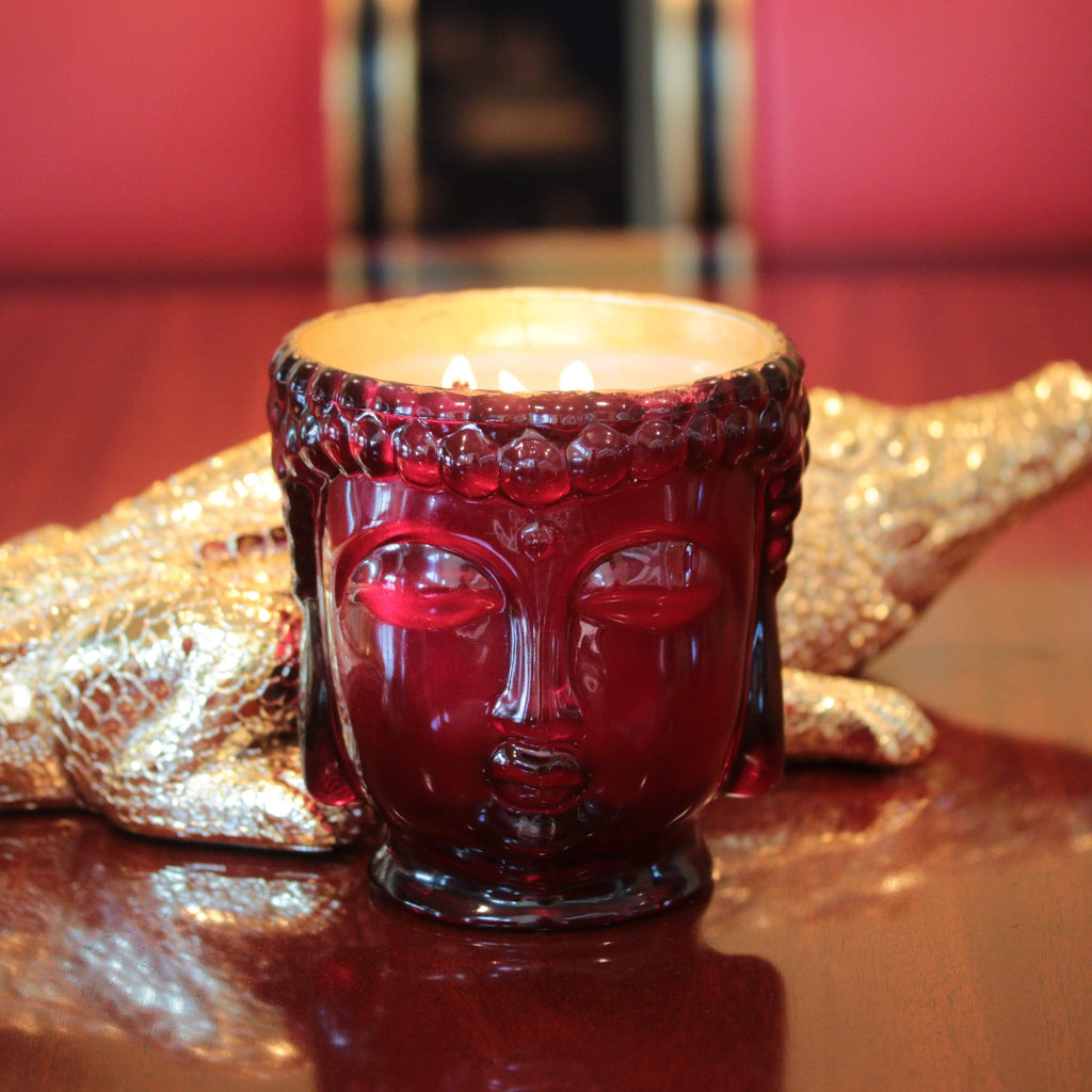 glass red buddha head candle lined with 24K gold
