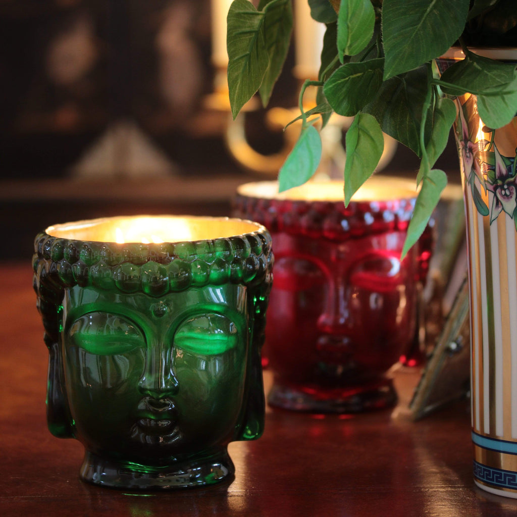 green glass buddha head candle lined with 24K gold interior