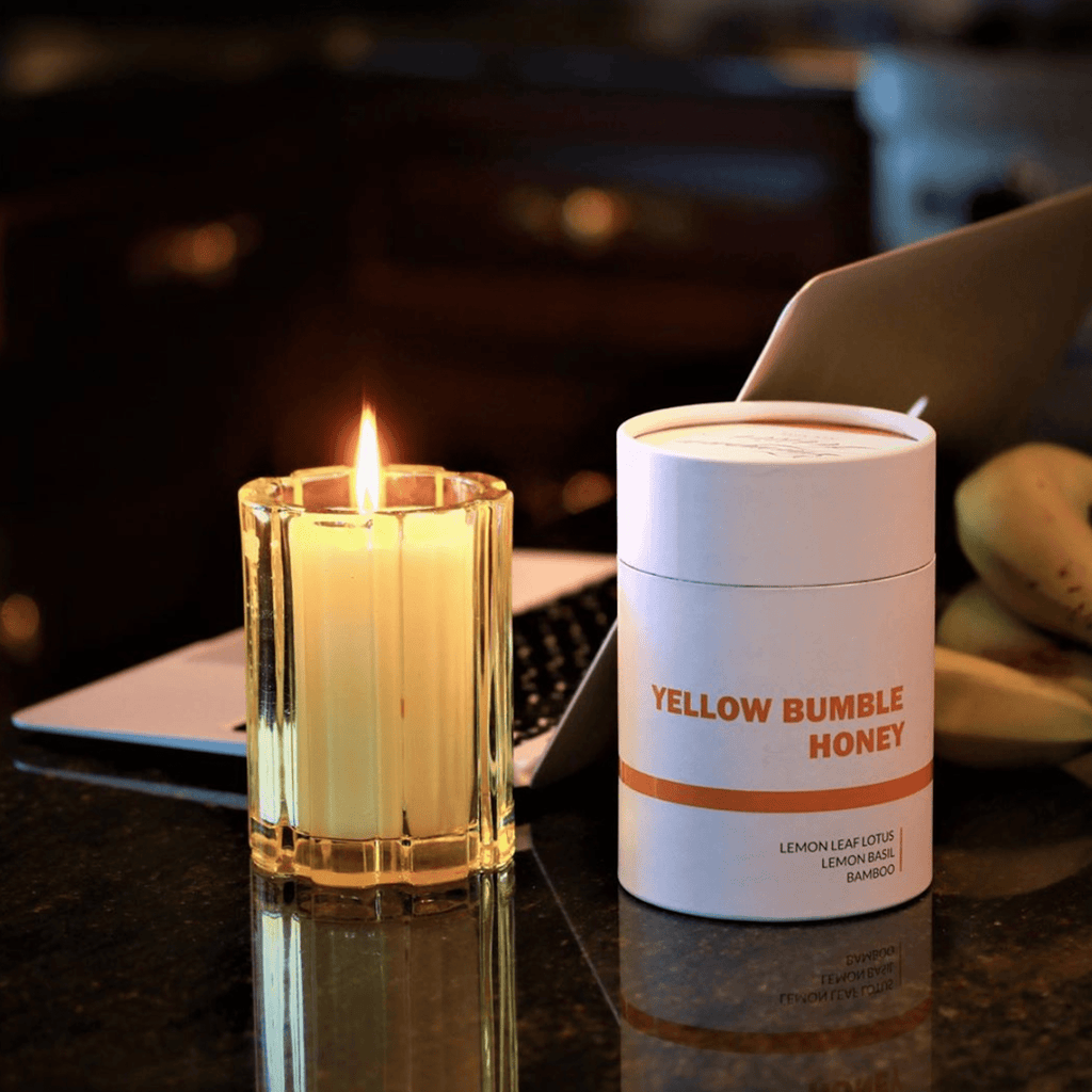 yellow glass candle with soy wax, essential oils and a cotton wick
