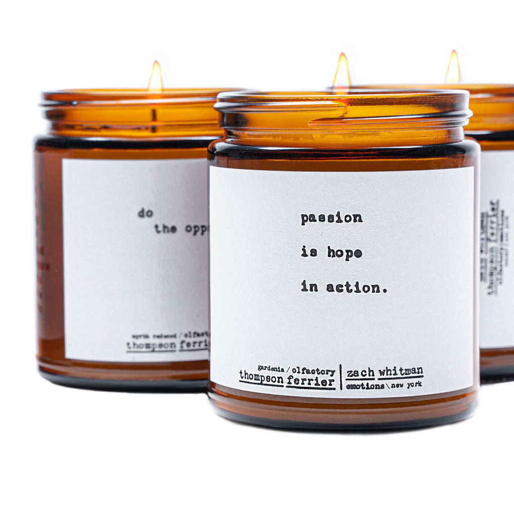 brown glass jar with a white label on it and white wax with a single cotton wick