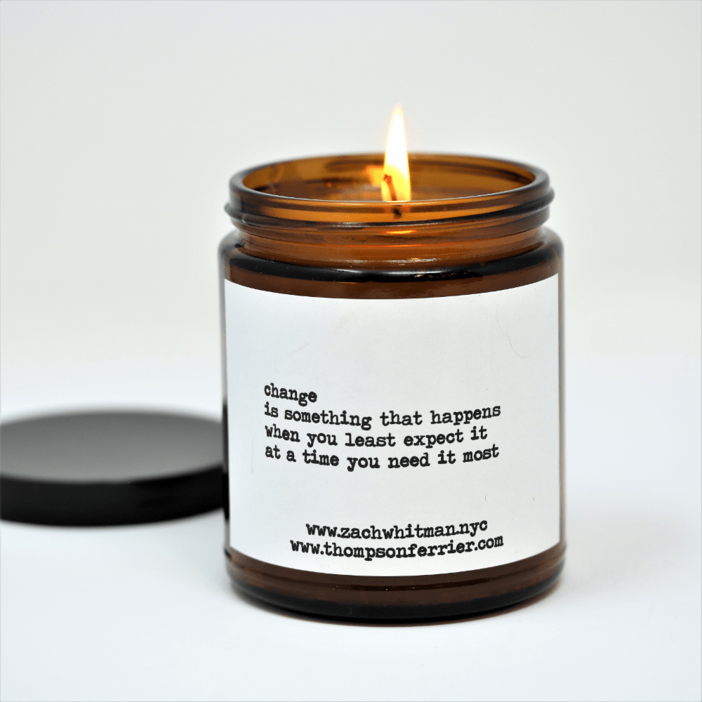 Thompson Ferrier scented candle in amber colored jar with black lid