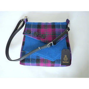 Harris Tweed bag, shoulder bag, crossbody bag in bright blue and cerise check with a front pocket and flap finished with three decorative buttons and a black leather strap