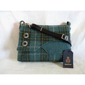 The lovely Brancaster shoulder/ crossbody bag in blue green check Harris Tweed with a plain blue green front pocket and check flap finished with two large decorative buttons. This bag has a plain black lining with large inner zipped pocket, it has a magnetic snap fastener under the flap and a clip on black leather strap which is adjustable to approximately 120 cm (47 inches) not including clips and rings and as with all my bags, it has the Harris Tweed orb mark label on the inside.
