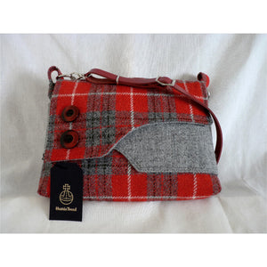 The lovely Brancaster shoulder/ crossbody bag in red and grey check Harris Tweed with a plain grey front pocket and check flap finished with two large decorative buttons. This bag has a plain red lining with large inner zipped pocket, it has a magnetic snap fastener under the flap and a clip on red leather strap which is adjustable to approximately 120 cm (47 inches) not including clips and rings and as with all my bags, it has the Harris Tweed orb mark label on the inside.