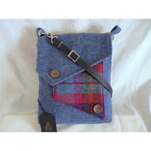 Load image into Gallery viewer, Mortson Quay messenger/ crossbody bag in chalky blue Harris Tweed with a multicoloured check front pocket and plain flap finished with two coconut shell buttons. This bag has a plain navy lining with an inner zipped pocket, it has a magnetic snap fastener under the flap and a clip on navy leather strap which is adjustable to approximately 120 cm (47 inches) not including clips and rings and as with all my bags, it has the Harris Tweed orb mark label on the inside.