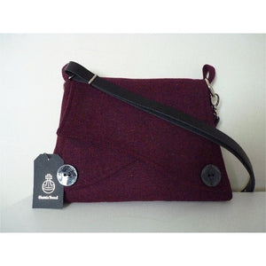 Harris Tweed bag, shoulder bag, crossbody bag in burgundy with a front pocket and flap with large decorative buttons ans a black leather strap.