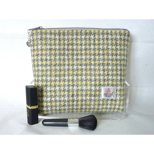 Handmade Harris Tweed cosmetic bag in cream, grey and lemon houndstooth fabric.