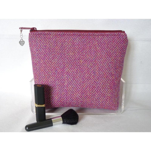 Handmade Harris Tweed cosmetic bag in deep plumy pink herringbone fabric with hints of lemon.
