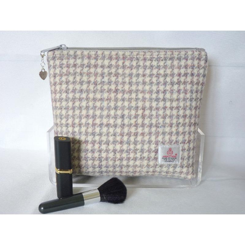 Handmade Harris Tweed cosmetic bag in cream and grey hounds tooth check fabric with hints of pink.