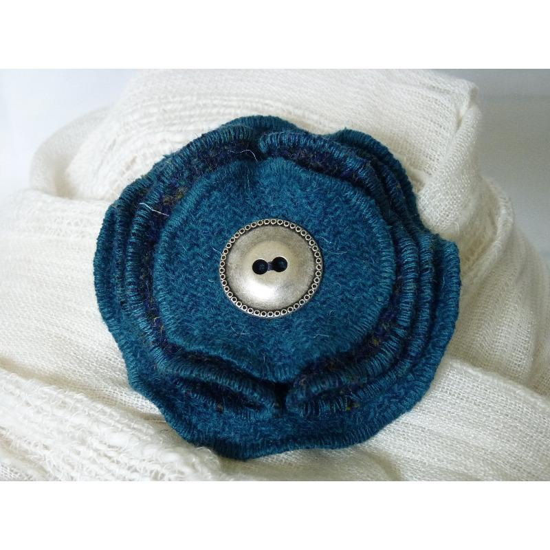 Harris Tweed brooch with two plain teal and two folded small multi check layers finished with a decorative pewter button.