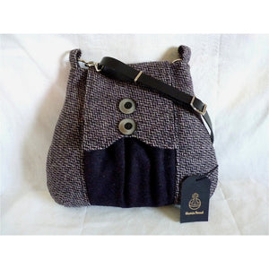 Harris Tweed bag, shoulder bag, crossbody bag in dark purple and pink and grey tile effect with a front pocket and flap trimmed with two decorative buttons and a black leather strap.