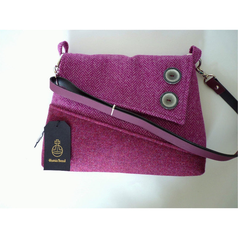 Harris Tweed bag, shoulder bag, crossbody bag in raspberry and pink herringbone with a flap finished with two decorative buttons and a raspberry leather strap