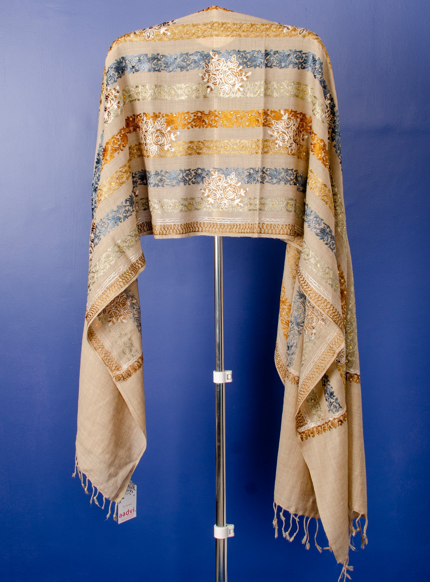 BEIGE WOVEN PASHMINA STOLE WITH BEAUTIFUL THREAD EMBROIDERY AND STONE PASTING.