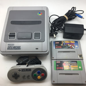 Super Nintendo Entertainment System (SNES) with two games, all cords and controller
