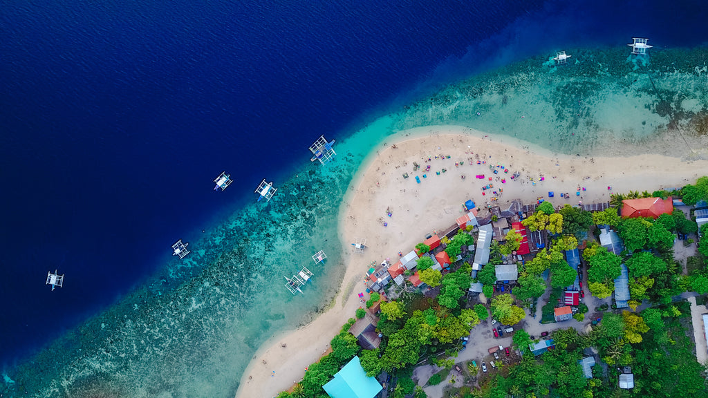 Aerial photography of a beautiful beach with a white sand and a blue sea.