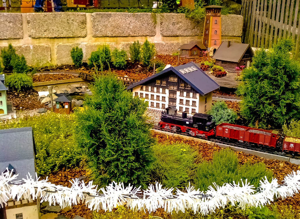 Miniature of a village with train and parks