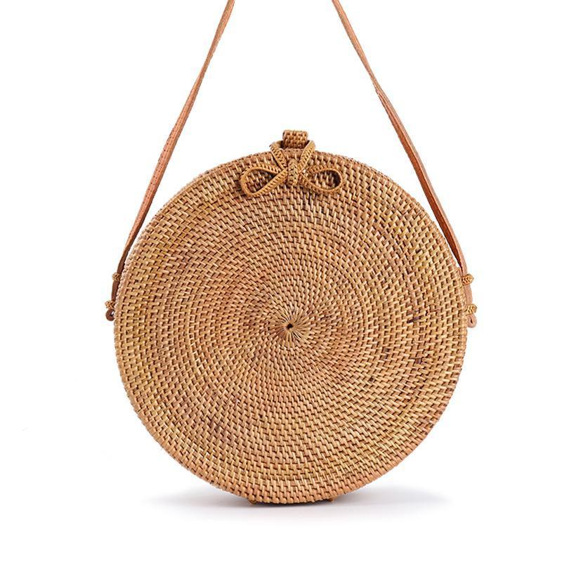 Round rattan circle bag with leather strap