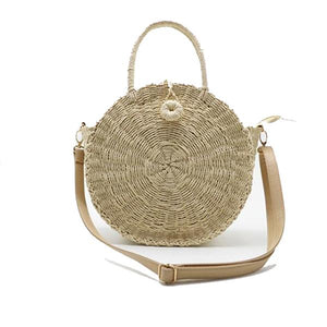 Beige straw bag with leather strap