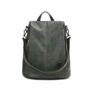 green leather backpack purse