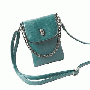Green crossbody phone bag with skull head